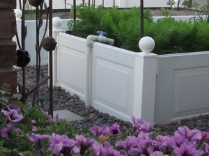 Raised garden beds made with garage door panels www.lifeatthecottage.com