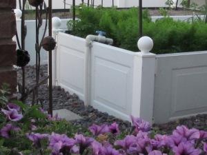 Raised garden beds made with garage door panels www.lifeatthecottage.com