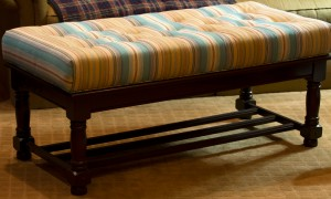 A coffee table up-cycled to an upholstered bench. www.lifeatthecottage.com