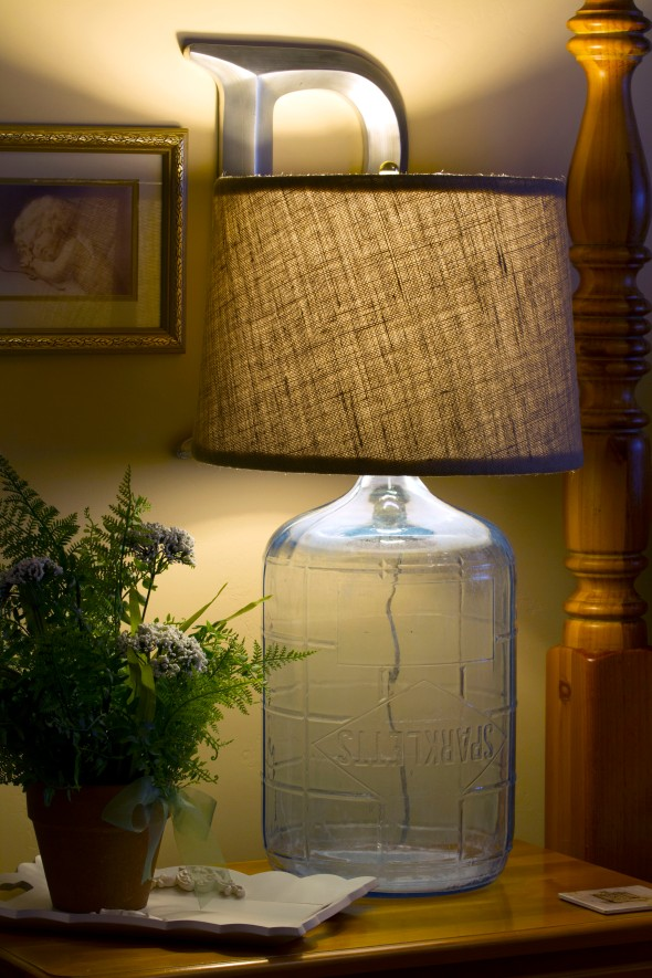 A large glass water bottle made into a lamp. www.lifeatthecottage.com
